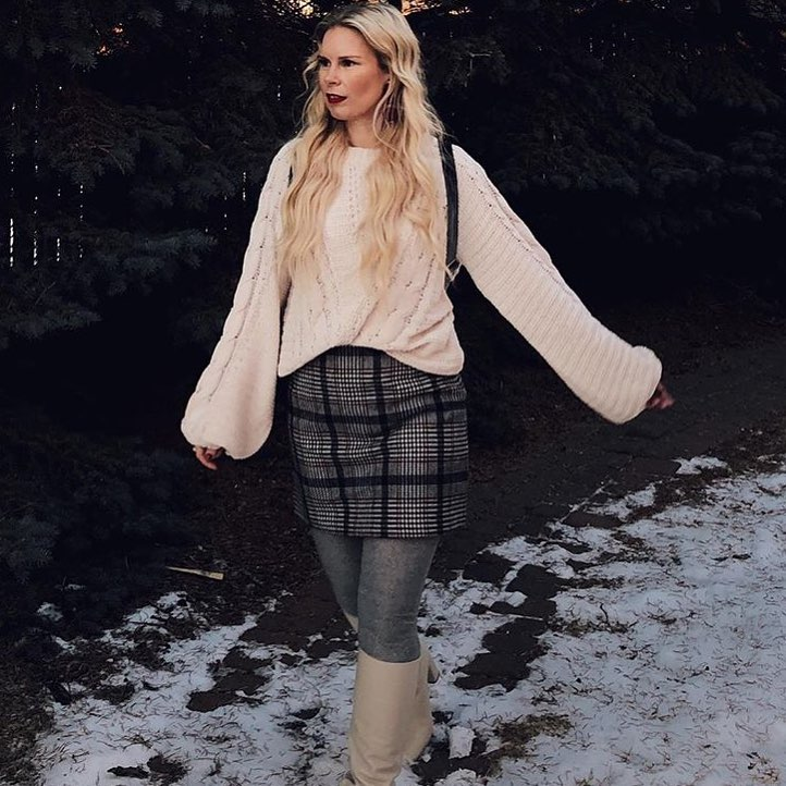 Alana @ilovedenham Trend Setter shopping in the fall with a cute tartan skirt and cozy sweater in the winter with snow on the ground