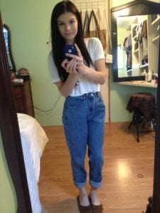 Austyn Paula at 18 years old wearing high waisted jeans and a tshirt