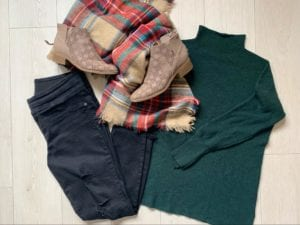 Dark jeans, green sweater, plaid scarf, and suede booties; all part of fall fashion for Kara