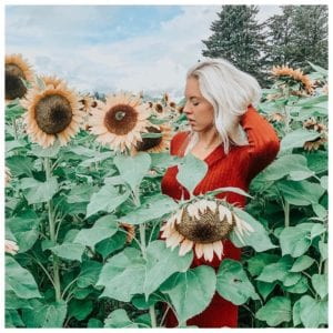 Carly @CarlyMal is a trend setter based in Kelowna, here wearing a red dress in a field of sunflowers