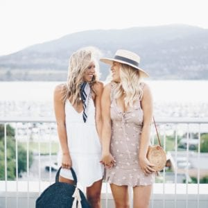 Jordan Sangster (@Jsangsterr) is a Kelowna-based blogger that loves to travel; here she is standing against a beautiful Okanagan lake view with a friend, wearing a white dress